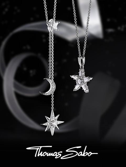 Black background magic stars three necklaces