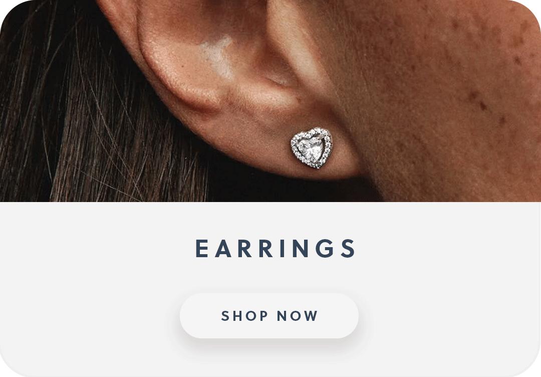 Close up of an ear with a Pandora heart earring