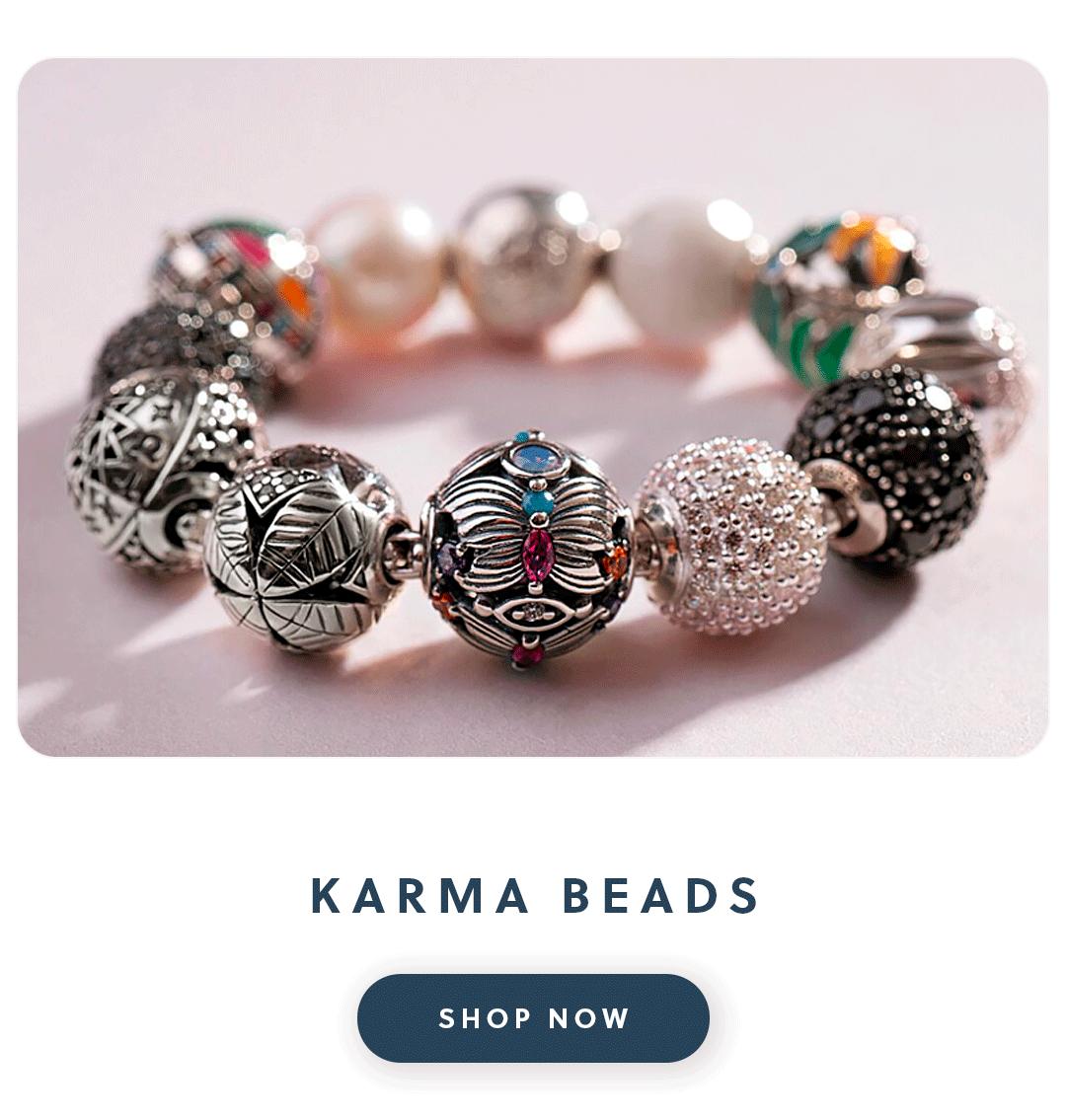 A thomas sabo karma bead bracelet full of karma beads with text karma beads shop now