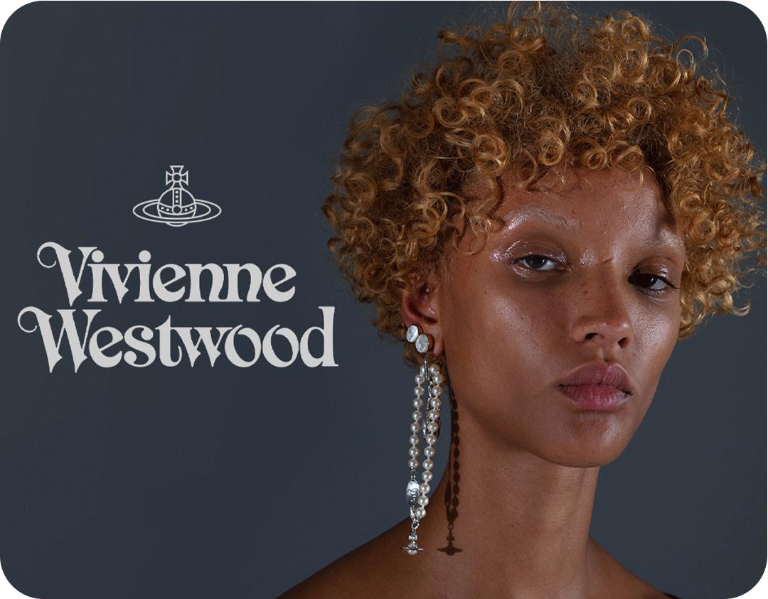 A headshot of a woman wearing a Vivienne Westwood earring